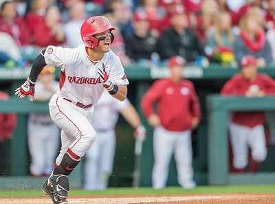 Arkansas infielder Rick Nomura (1) heads for first base during a baseball game between Arkansas and Auburn on 3-25-16.  (Alan Jamison, Nate Allen Sports Service)