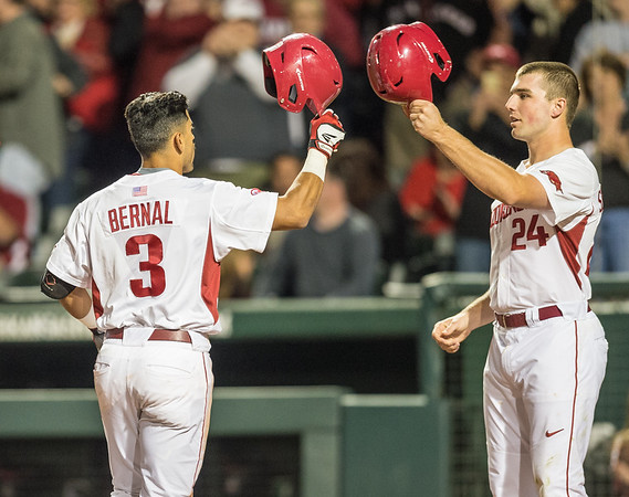 Arkansas infielder Michael Bernal (3) celebrates a home run with Chad Spanberger during a baseball game between Arkansas and Auburn on 3-26-16.  (Alan Jamison, Nate Allen Sports Service)