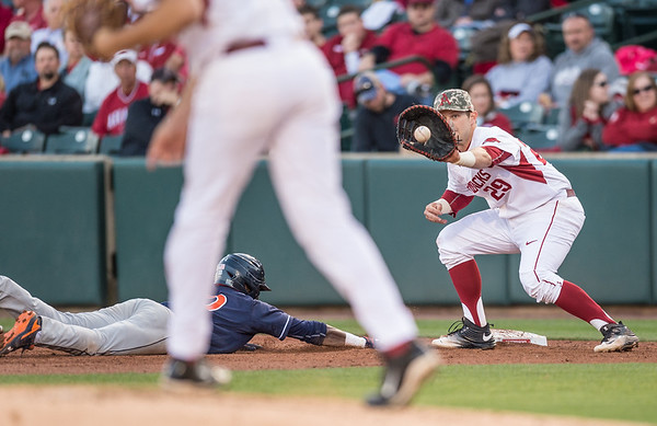Arkansas infielder Cullen Gassaway (29) receives the ball at first base from Keaton McKinney during a baseball game between Arkansas and Auburn on 3-26-16.  (Alan Jamison, Nate Allen Sports Service)