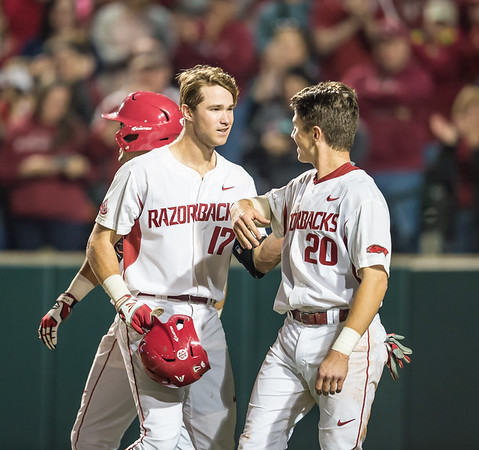 Arkansas catcher Carson Shaddy (20) congratulates Luke Bonfield on Bonfield's home run during a baseball game between Arkansas and Auburn on 3-26-16.  (Alan Jamison, Nate Allen Sports Service)