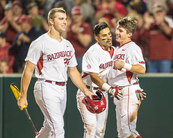 Arkansas catcher Carson Shaddy (20) congratulates Michael Bernal on a home run during a baseball game between Arkansas and Auburn on 3-26-16.  (Alan Jamison, Nate Allen Sports Service)
