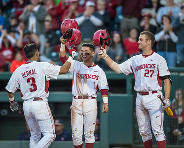 Arkansas infielder Michael Bernal (3) celebrates a home run with Rick Nomura and Tucker Pennell during a baseball game between Arkansas and Auburn on 3-26-16.  (Alan Jamison, Nate Allen Sports Service)