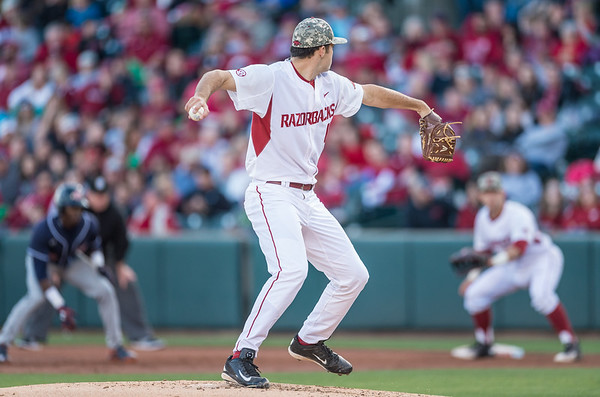 Arkansas pitcher Keaton McKinney (11) throws to first base during a baseball game between Arkansas and Auburn on 3-26-16.  (Alan Jamison, Nate Allen Sports Service)