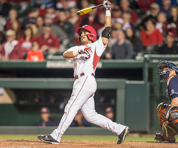 Arkansas infielder Michael Bernal (3) hits one of his two home runs during a baseball game between Arkansas and Auburn on 3-26-16.  (Alan Jamison, Nate Allen Sports Service)