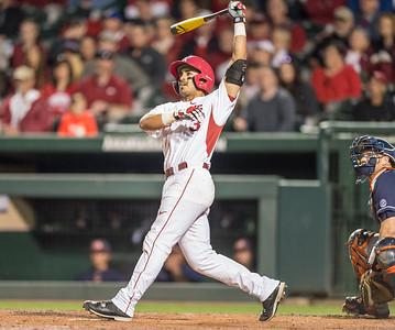 Arkansas infielder Michael Bernal (3) hits one of his two home runs during a baseball game between Arkansas and Auburn on 3-26-16.  (Alan Jamison, Nate Allen Sports Service)