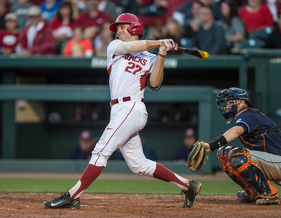 Arkansas catcher Tucker Pennell (27) bats during a baseball game between Arkansas and Auburn on 3-26-16.  (Alan Jamison, Nate Allen Sports Service)