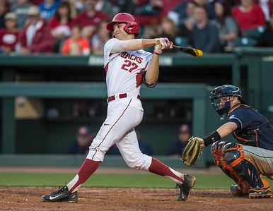 Arkansas catcher Tucker Pennell (27) bats during a baseball game between Arkansas and Auburn on 3-26-16.  (Alan Jamison, Nate Allen Sports Service)