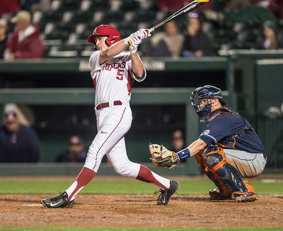 Arkansas infielder Cody Scroggins (5) bats during a baseball game between Arkansas and Auburn on 3-26-16.  (Alan Jamison, Nate Allen Sports Service)