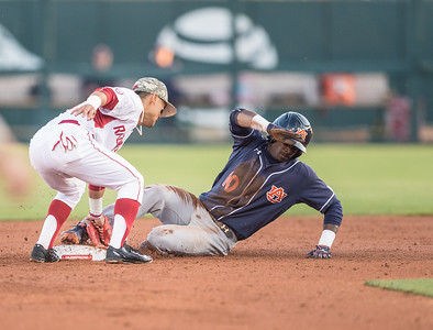 Arkansas infielder Rick Nomura (1) tags Auburn outfielder Anfernee Grier (10) at second base during a baseball game between Arkansas and Auburn on 3-26-16.  (Alan Jamison, Nate Allen Sports Service)