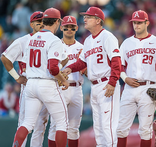 Arkansas head coach Dave Van Horn gives the ball to relief pitcher Josh Alberius during a baseball game between Arkansas and Missouri on 4-1-16.  (Alan Jamison, Nate Allen Sports Service)
