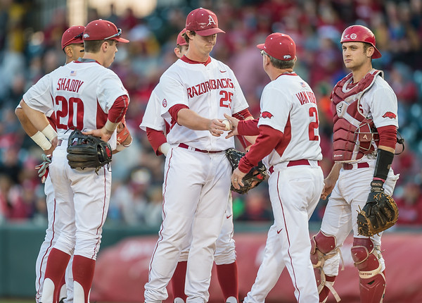 Arkansas head coach Dave Van Horn takes the ball from starting pitcher Dominic Taccolini during a baseball game between Arkansas and Missouri on 4-1-16.  (Alan Jamison, Nate Allen Sports Service)