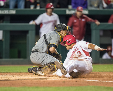 Arkansas infielder Michael Bernal (3) scores during a baseball game between Arkansas and Missouri on 4-1-16.  (Alan Jamison, Nate Allen Sports Service)
