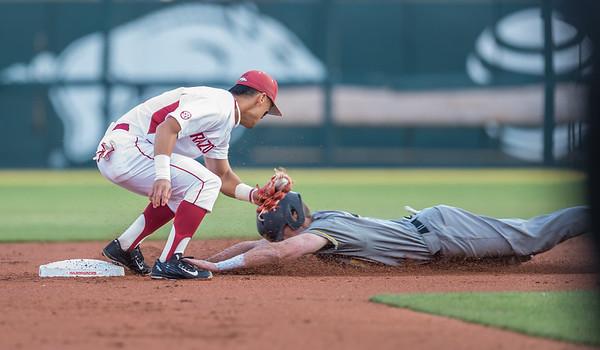 Arkansas infielder Rick Nomura (1) tags out a Missouri player at second base during a baseball game between Arkansas and Missouri on 4-1-16.  (Alan Jamison, Nate Allen Sports Service)