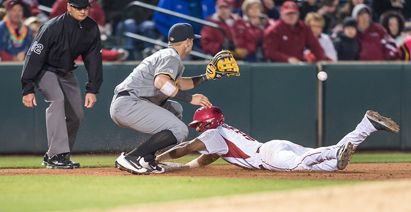Arkansas infielder Michael Bernal (3) beats the ball to third base during a baseball game between Arkansas and Missouri on 4-1-16.  (Alan Jamison, Nate Allen Sports Service)