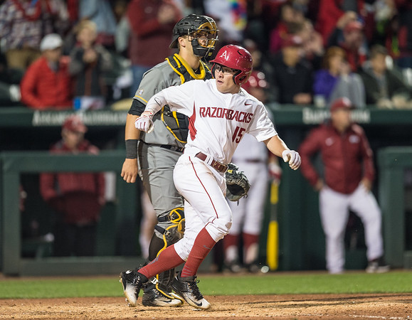 Arkansas outfielder Jake Arledge (15) scores during a baseball game between Arkansas and Missouri on 4-1-16.  (Alan Jamison, Nate Allen Sports Service)