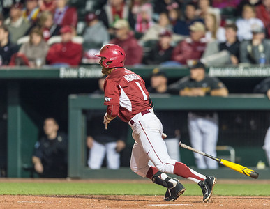 Arkansas infielder Rick Nomura (1) hits during a baseball game between Arkansas and Missouri on 4-2-16.  (Alan Jamison, Nate Allen Sports Service)