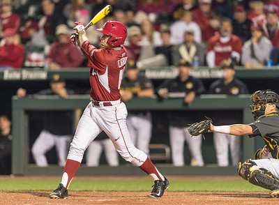 Arkansas outfielder Austin Catron (19) watches his home run leave the park  during a baseball game between Arkansas and Missouri on 4-2-16.  (Alan Jamison, Nate Allen Sports Service)
