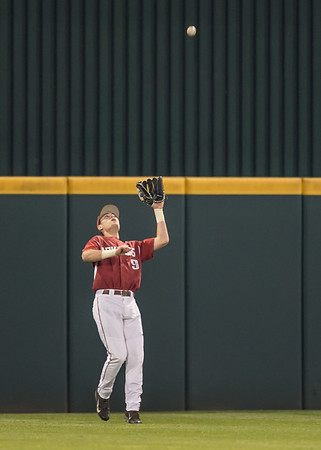 Arkansas outfielder Clark Eagan (9) catches a fly ball during a baseball game between Arkansas and Missouri on 4-2-16.  (Alan Jamison, Nate Allen Sports Service)