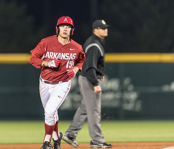 Arkansas outfielder Austin Catron (19) rounds the bases after hitting one out of the park during a baseball game between Arkansas and Missouri on 4-2-16.  (Alan Jamison, Nate Allen Sports Service)