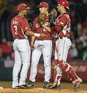 Arkansas pitcher James Teague (28) gets visited at the mound by Michael Bernal and Tucker Pennell during a baseball game between Arkansas and Missouri on 4-2-16.  (Alan Jamison, Nate Allen Sports Service)