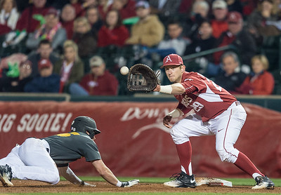 Arkansas infielder Cullen Gassaway (29) prepares to tag Arkansas pitcher Dominic Taccolini (25) at first base  during a baseball game between Arkansas and Missouri on 4-2-16.  (Alan Jamison, Nate Allen Sports Service)