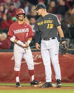 Arkansas infielder Rick Nomura (1) chats with Missouri infielder Zach Lavy (13) at first base during a baseball game between Arkansas and Missouri on 4-2-16.  (Alan Jamison, Nate Allen Sports Service)