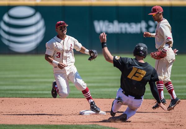 Arkansas infielder Michael Bernal (3) forces out Missouri infielder Zach Lavy (13) during a baseball game between Arkansas and Missouri on 4-3-16.  (Alan Jamison, Nate Allen Sports Service)