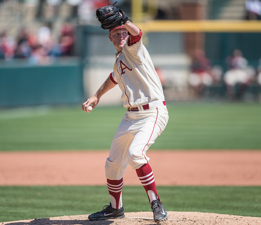Arkansas pitcher Zach Jackson (32) pitches to first base during a baseball game between Arkansas and Missouri on 4-3-16.  (Alan Jamison, Nate Allen Sports Service)