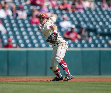 Arkansas catcher Carson Shaddy (20) pitches to first base during a baseball game between Arkansas and Missouri on 4-3-16.  (Alan Jamison, Nate Allen Sports Service)