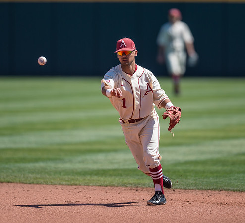 Arkansas infielder Rick Nomura (1) throws to first base during a baseball game between Arkansas and Missouri on 4-3-16.  (Alan Jamison, Nate Allen Sports Service)