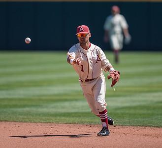 Arkansas infielder Rick Nomura (1) throws to first base during a baseball game between Arkansas and Missouri on 4-3-16.  (Alan Jamison, Nate Allen Sports Service)