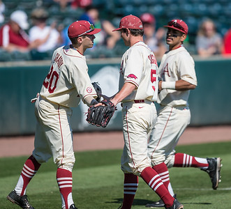 Arkansas catcher Carson Shaddy (20) congratulates Cody Scroggins on his pitching appearance during a baseball game between Arkansas and Missouri on 4-3-16.  (Alan Jamison, Nate Allen Sports Service)