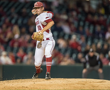 Arkansas pitcher Josh Alberius (10) throws to first base during a baseball game between Arkansas and Florida on 4/14/2016.   (Alan Jamison, Nate Allen Sports Service)