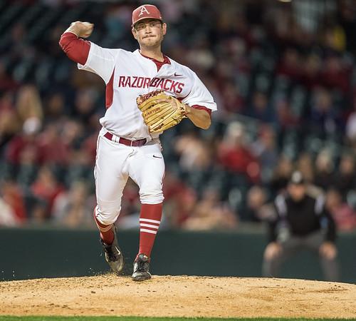 Arkansas pitcher Josh Alberius (10) throws to first base during a baseball game between Arkansas and Florida on 4/14/2016.   (Alan Jamison, Nate Allen Sports Service)