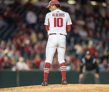 Arkansas pitcher Josh Alberius (10) glimpses first base  during a baseball game between Arkansas and Florida on 4/14/2016.   (Alan Jamison, Nate Allen Sports Service)
