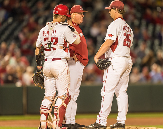 Arkansas pitcher Dominic Taccolini (25) visits with pitching coach Dave Jorn and Tucker Pennell on the moundduring a baseball game between Arkansas and Florida on 4/14/2016.   (Alan Jamison, Nate Allen Sports Service)