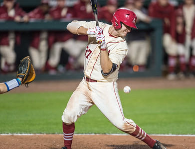 Arkansas catcher Tucker Pennell (27) gets hit by the ball during a baseball game between Arkansas and Florida on 4/16/2016.   (Alan Jamison, Nate Allen Sports Service)