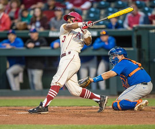 Arkansas infielder Michael Bernal (3) hits a home run during a baseball game between Arkansas and Florida on 4/16/2016.   (Alan Jamison, Nate Allen Sports Service)