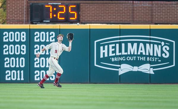 Arkansas outfielder Clark Eagan (9) fields a fly ball during a baseball game between Arkansas and Florida on 4/16/2016.   (Alan Jamison, Nate Allen Sports Service)