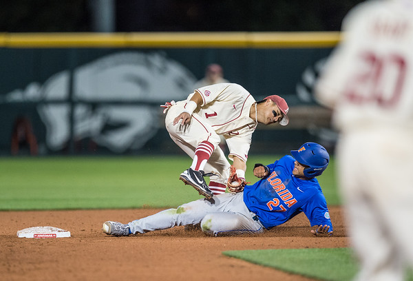 Arkansas infielder Rick Nomura (1) tags out Florida infielder Nelson Maldonado (27) at second base during a baseball game between Arkansas and Florida on 4/16/2016.   (Alan Jamison, Nate Allen Sports Service)