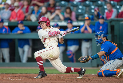 Arkansas outfielder Jake Arledge (15) hits a double during a baseball game between Arkansas and Florida on 4/16/2016.   (Alan Jamison, Nate Allen Sports Service)