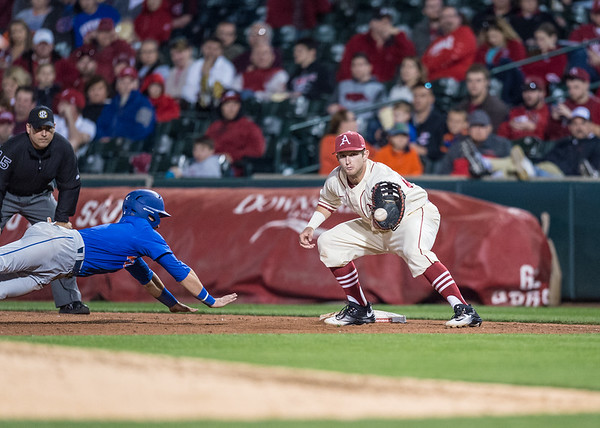 Arkansas infielder Cullen Gassaway (29) with the play at first base during a baseball game between Arkansas and Florida on 4/16/2016.   (Alan Jamison, Nate Allen Sports Service)