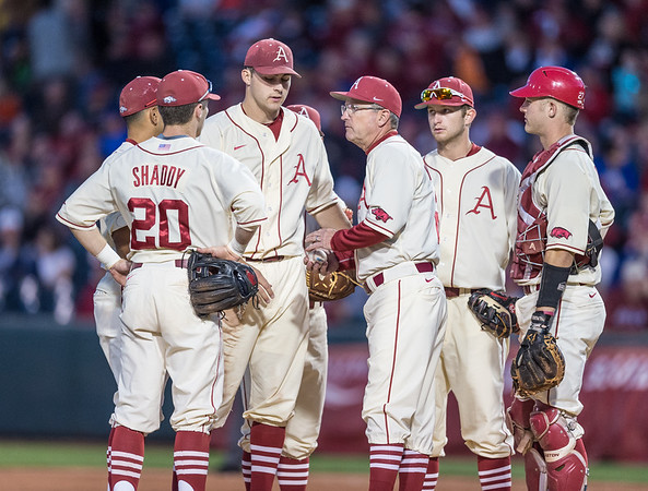 Arkansas pitcher Keaton McKinney (11) gives the ball to head coach Dave Van Horn and exits the game during a baseball game between Arkansas and Florida on 4/16/2016.   (Alan Jamison, Nate Allen Sports Service)