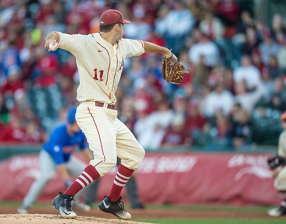 Arkansas pitcher Keaton McKinney (11) throws to first base during a baseball game between Arkansas and Florida on 4/16/2016.   (Alan Jamison, Nate Allen Sports Service)