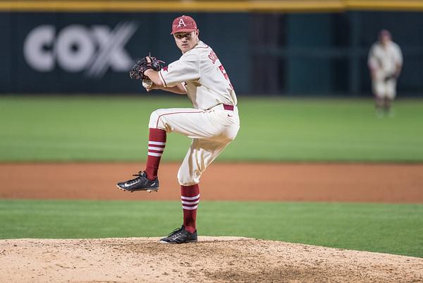 Arkansas infielder Cody Scroggins (5) pitches during a baseball game between Arkansas and Florida on 4/16/2016.   (Alan Jamison, Nate Allen Sports Service)