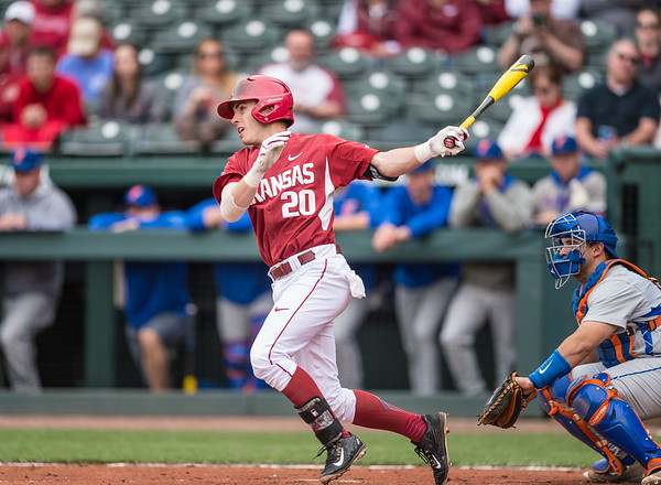 Arkansas catcher Carson Shaddy (20) bats during a baseball game between Arkansas and Florida on 4/16/2016.   (Alan Jamison, Nate Allen Sports Service)