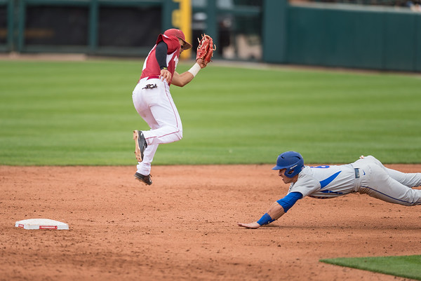 Arkansas infielder Rick Nomura (1) prepares for a tag at second base during a baseball game between Arkansas and Florida on 4/16/2016.   (Alan Jamison, Nate Allen Sports Service)