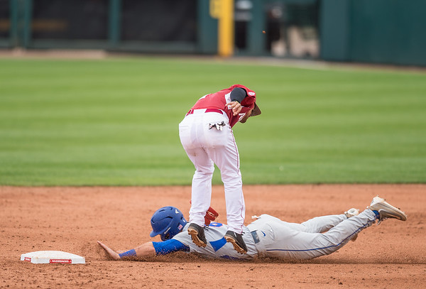 Arkansas infielder Rick Nomura (1) tags out Florida infielder Jonathan India (6) at second base during a baseball game between Arkansas and Florida on 4/16/2016.   (Alan Jamison, Nate Allen Sports Service)