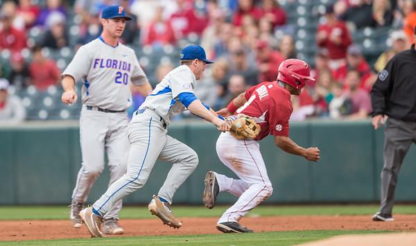 Arkansas infielder Michael Bernal (3) is caught in a run down during a baseball game between Arkansas and Florida on 4/16/2016.   (Alan Jamison, Nate Allen Sports Service)