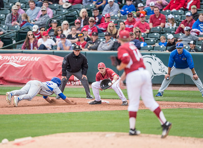 Arkansas outfielder Clark Eagan (9) prepares for a tag at first base during a baseball game between Arkansas and Florida on 4/16/2016.   (Alan Jamison, Nate Allen Sports Service)